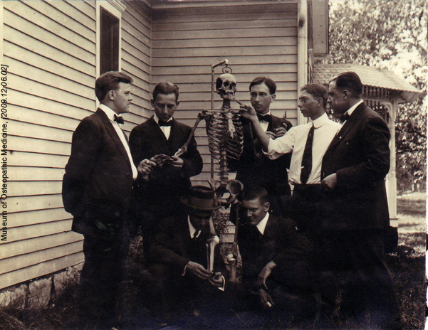 """Men Surrounding Skeleton"""